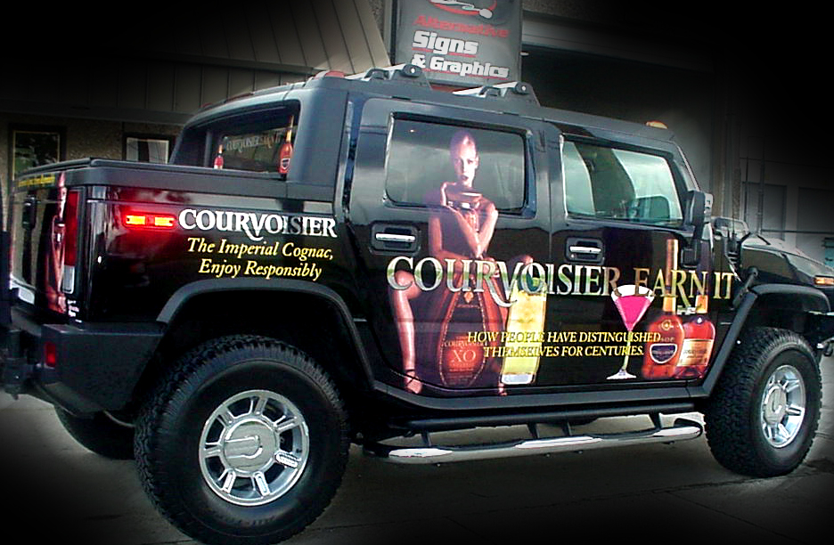 Installation of vehicle wrap in Metairie Louisiana for Courvoisier vehicle