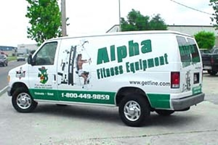 Installation of vinyl lettering on Alpha Fitness van