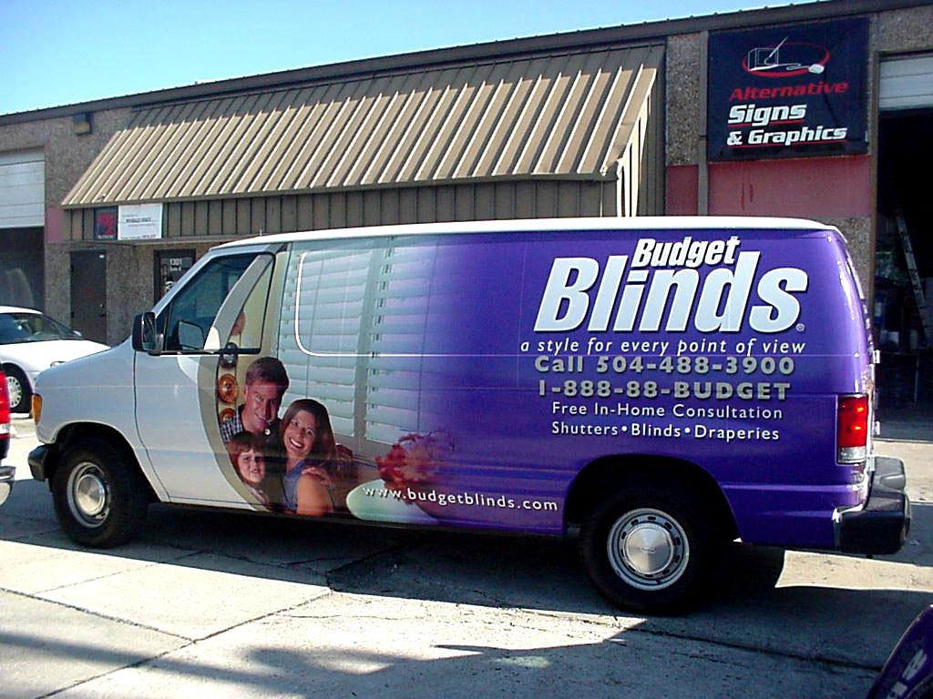 Installation of vehicle wrap and lettering on Budget Blinds van