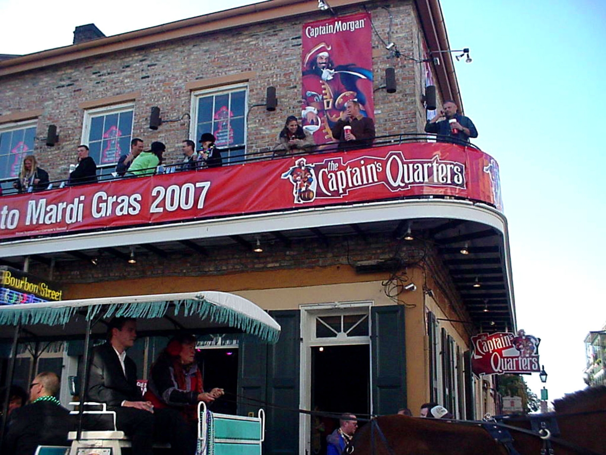 Banners installed Bourbon Street New Orleans for Captain Morgan Mardi Gras party