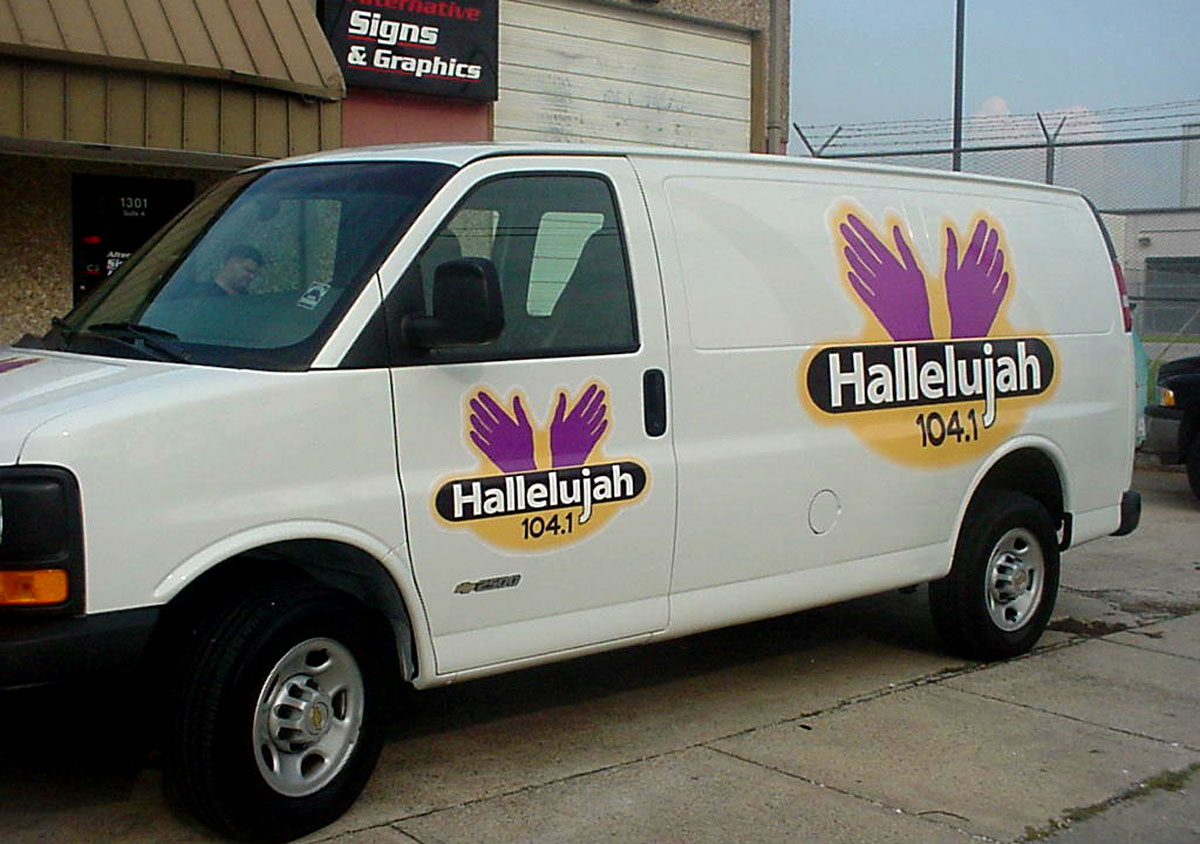 Vehicle lettering installed in New Orleans for church van