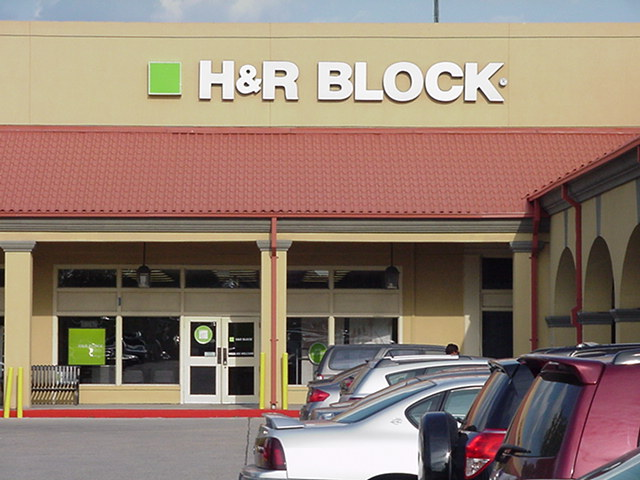 Sign installation New Orleans channel letter sign H&R Block