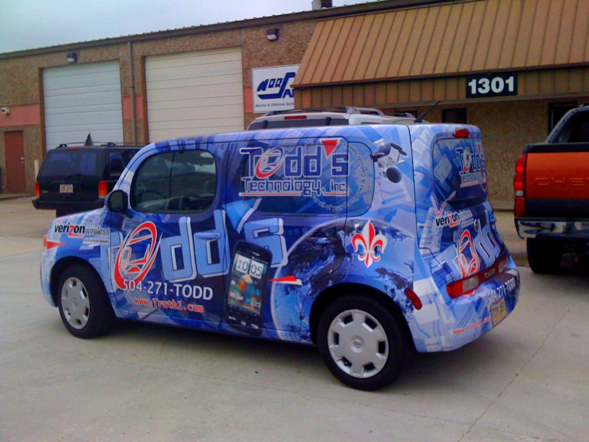 Install a vehicle wrap for Todd's Technology in Chalmette Louisiana