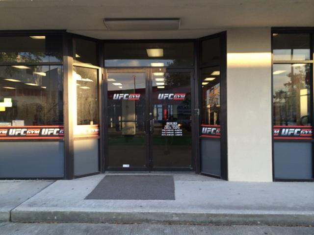 Window vinyl installed Metairie for UFC Gym