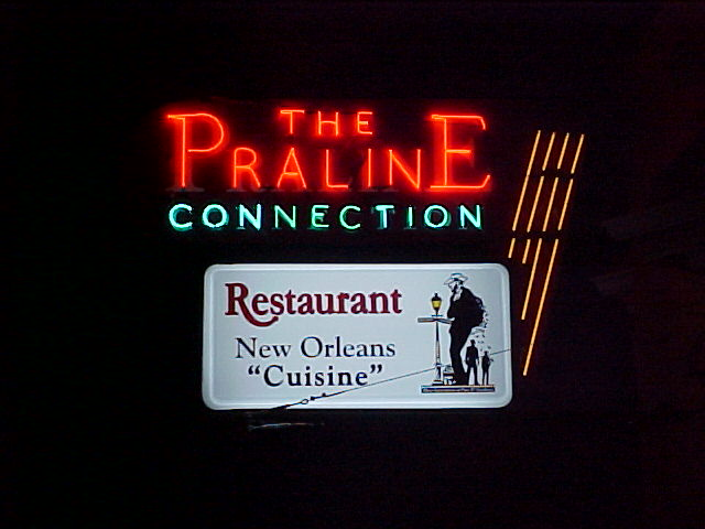 Historical neon sign refurbished in New Orleans Louisiana for Praline Connection