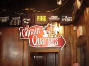Sign installation in New Orleans for Captain's Quarters Mardi Gras promotion