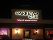Sign installation Metairie Louisiana channel letters for Caretta's Grill on Veterans