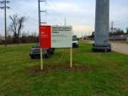 Sign installation in Harahan Army Corp job site sign