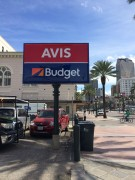 Pole sign installed in New Orleans on Canal Street for Avis Budget