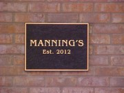 Bronze plaque for Manning's restaurant in New Orleans Louisiana